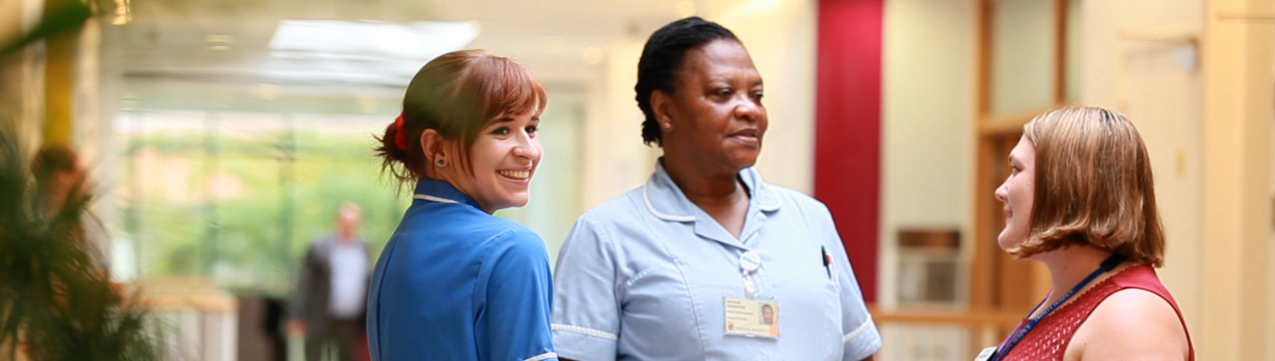 Nurses chat in Inpatient Unit